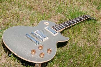 datant Gibson guitares par pots